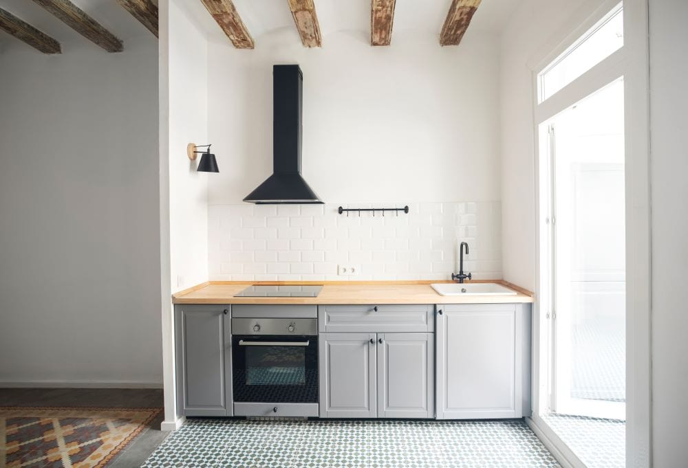 Mixed flooring design in industrial kitchen