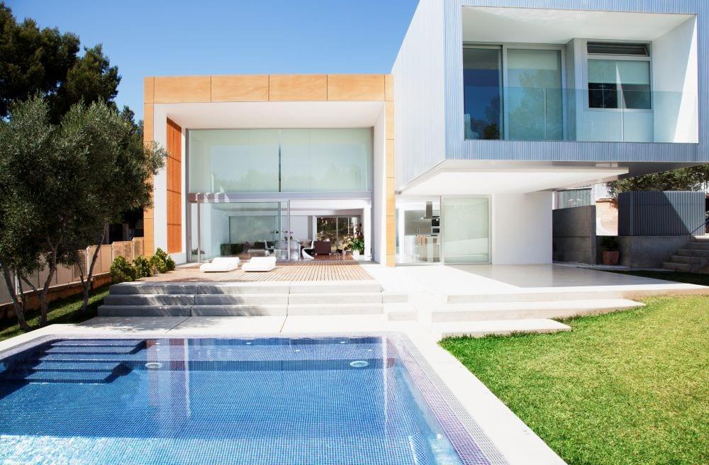 Lap pool in backyard of modern mansion