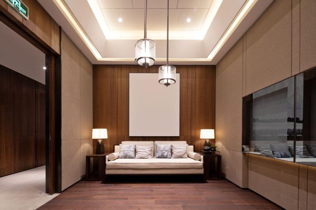 Modern living room with wood walls and modern pendant lighting