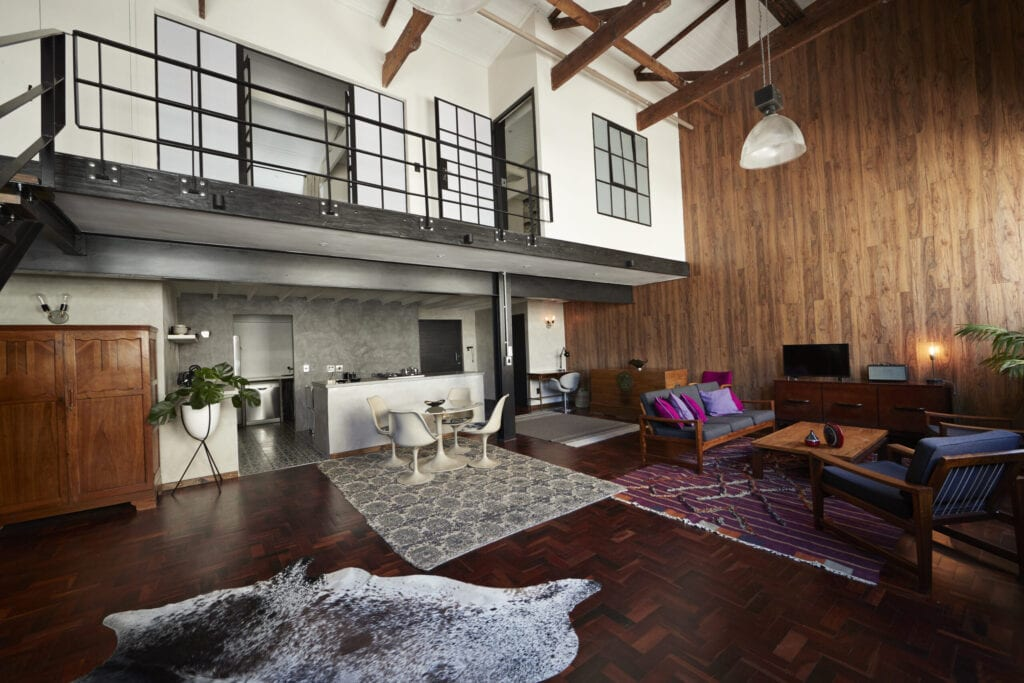 Urban loft-style flat in New York city, with brick and wood walls
