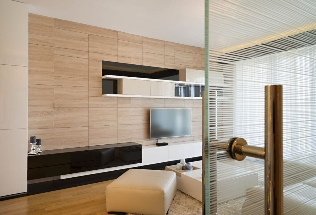 Modern living room with glass door and wood wall