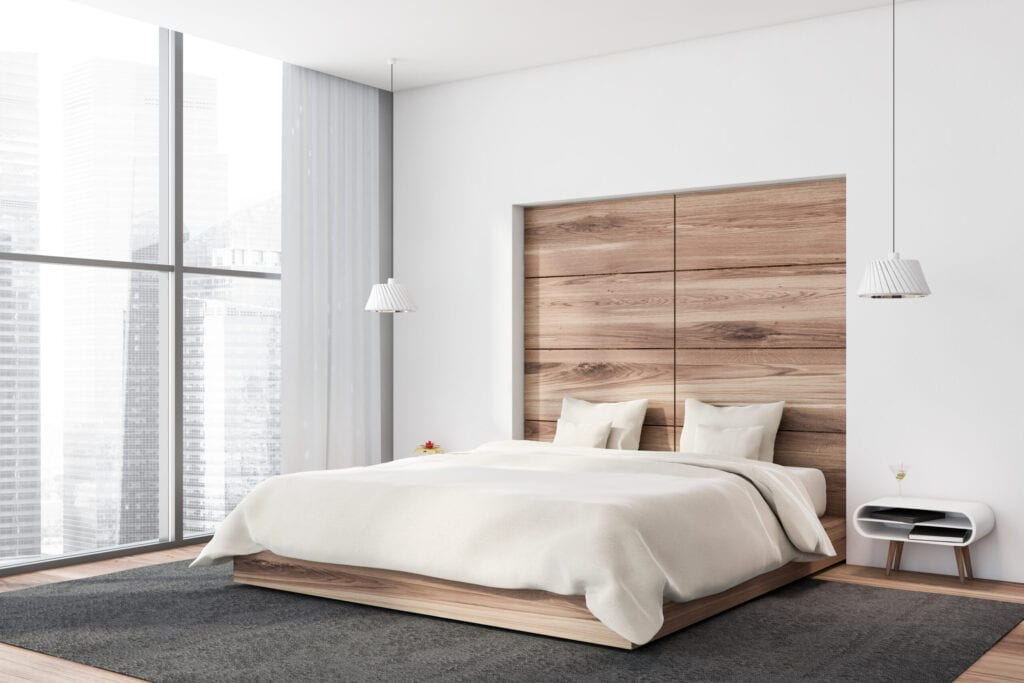 Modern bedroom with wooden headboard built into the wall