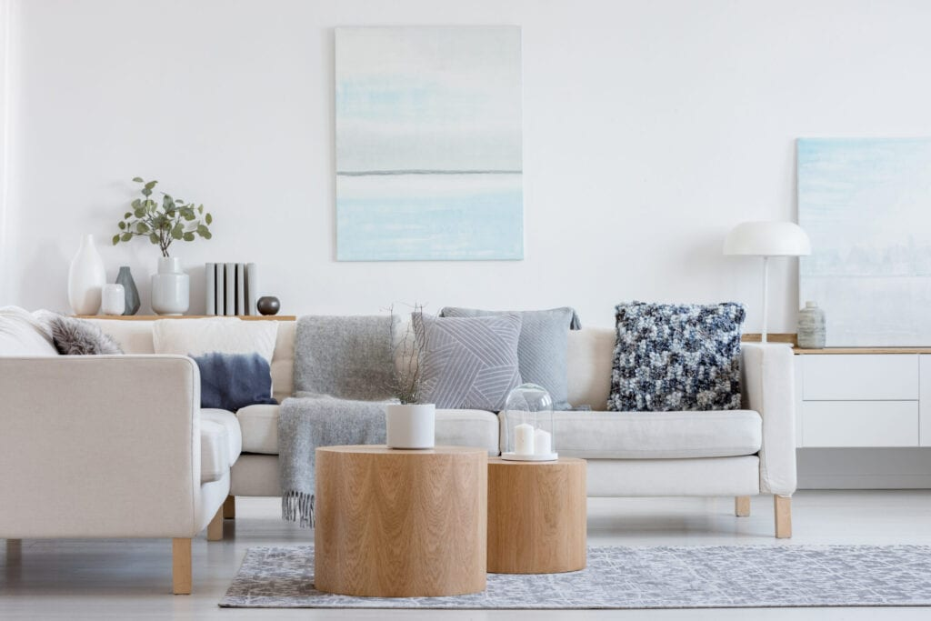 white couch with blue pillow living room decor