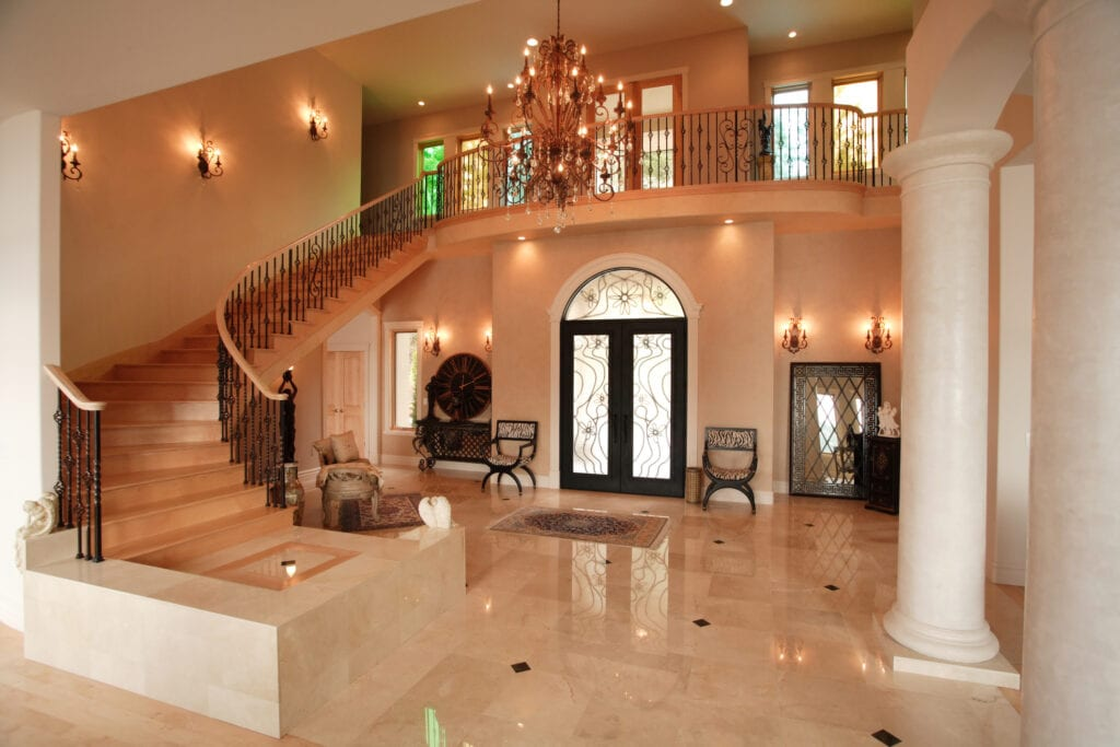 Luxury home interior with marble columns and large staircase