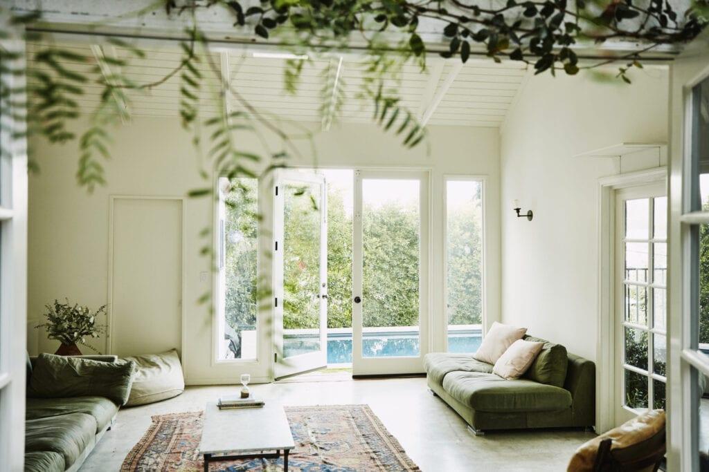Living room overlooking backyard pool