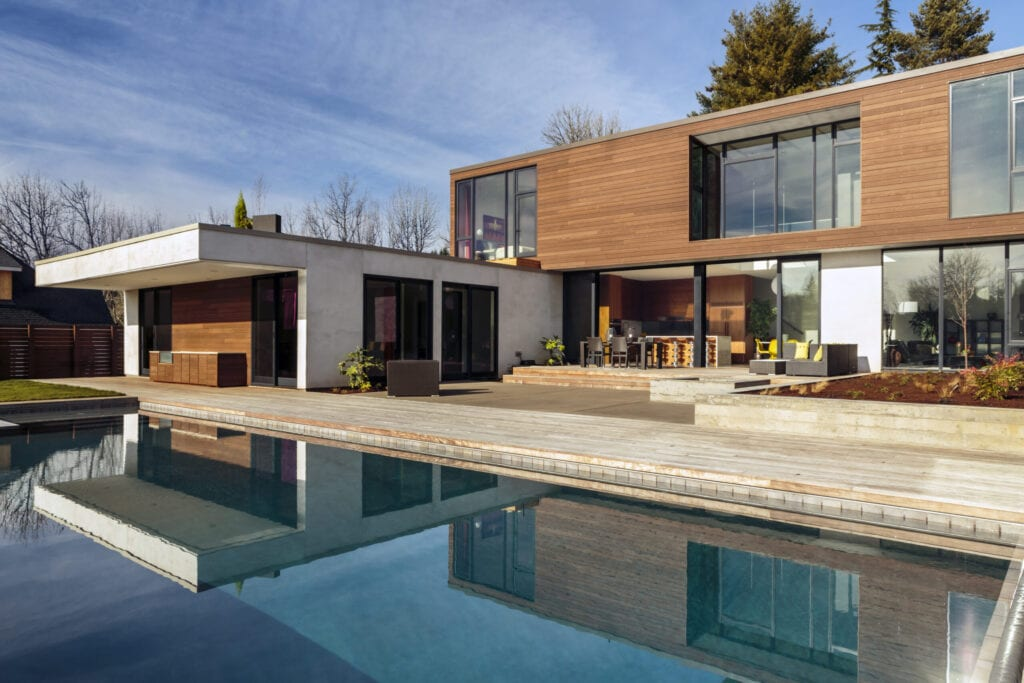 Large custom designed modern home with large swimming pool.