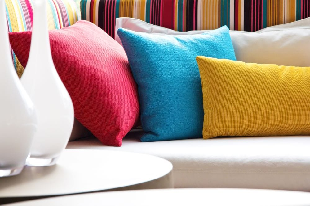 Close up of colorful pillows on couch