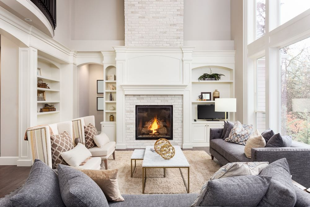 Luxury living room, fireplace and gray couches