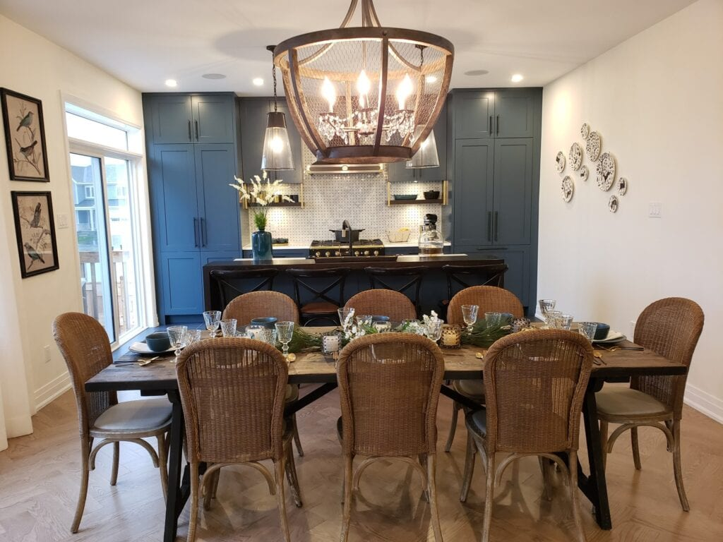 Set dining room and kitchen with blue accent wall