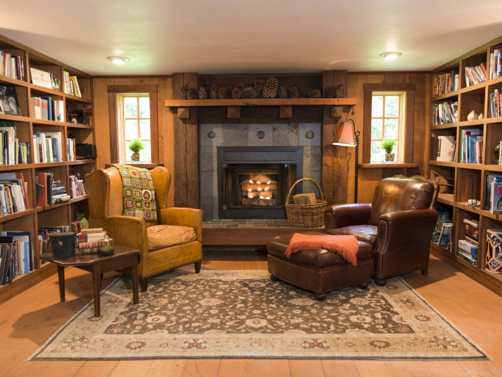 big fireplace and two leather chairs