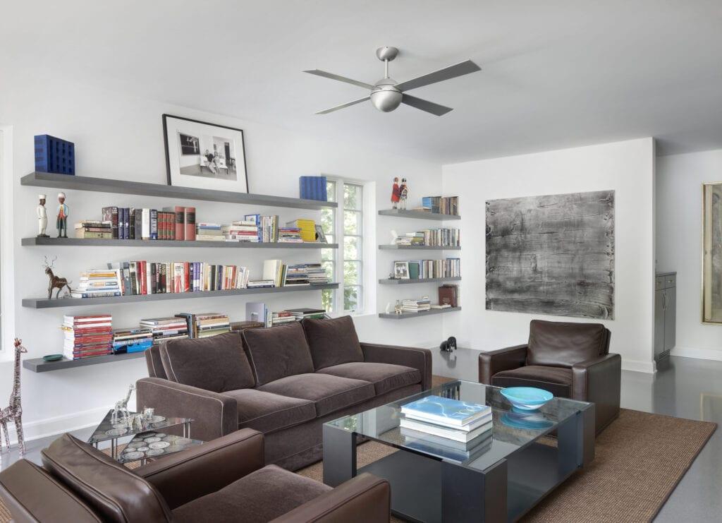 Modern Family room with modern bookshelves and Stainless steel fan.