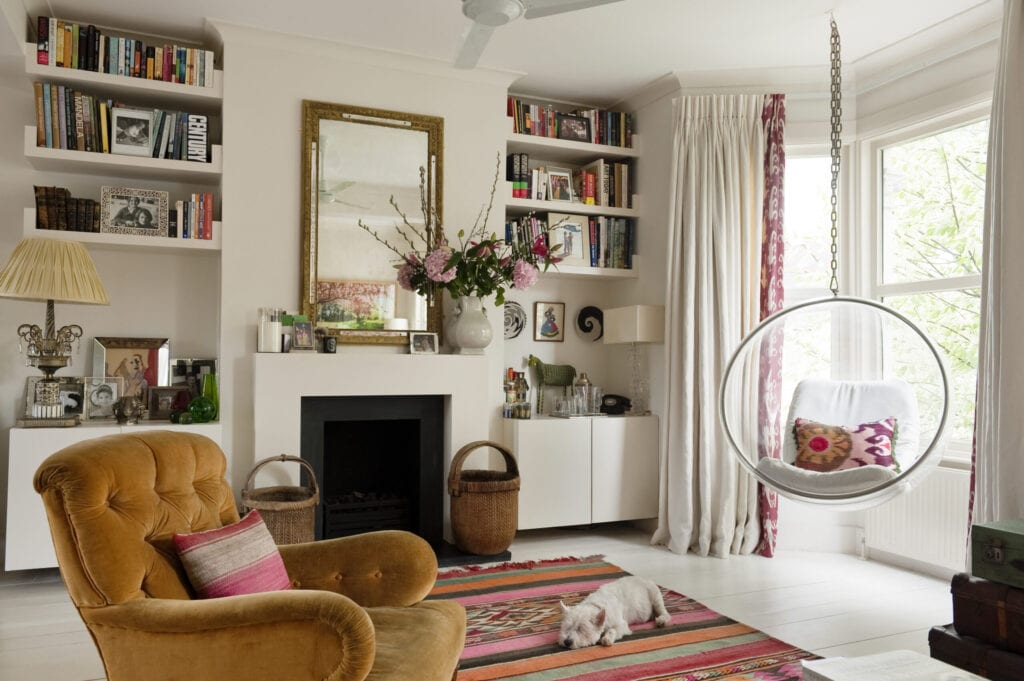 Living room with Eero Aarnio hanging bubble chair and vintage brown armchair