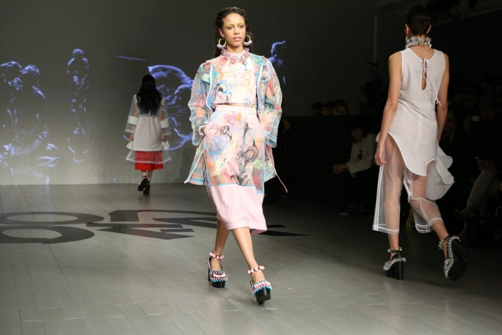 Model walking down runway