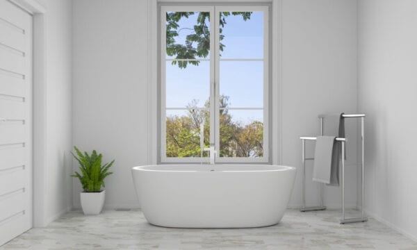 Modern bathroom with tub in front of large window