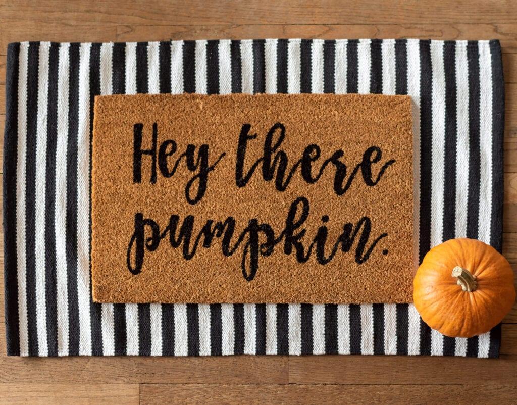 Cute fall rug and a pumpkin - stylish fall decor