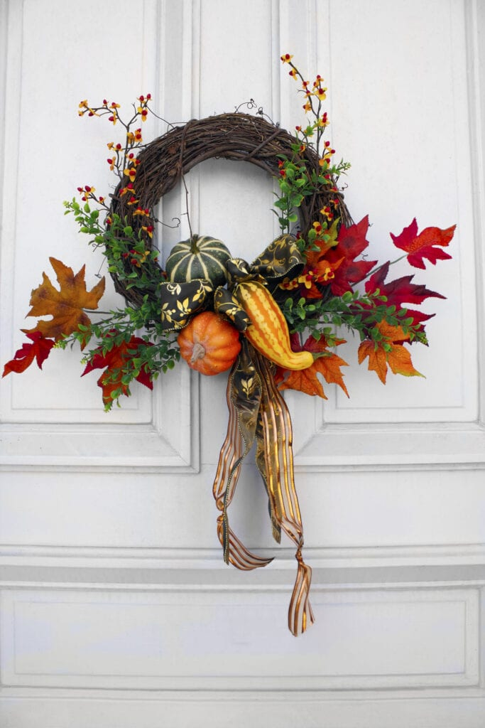 Autumn wreath on a white door.