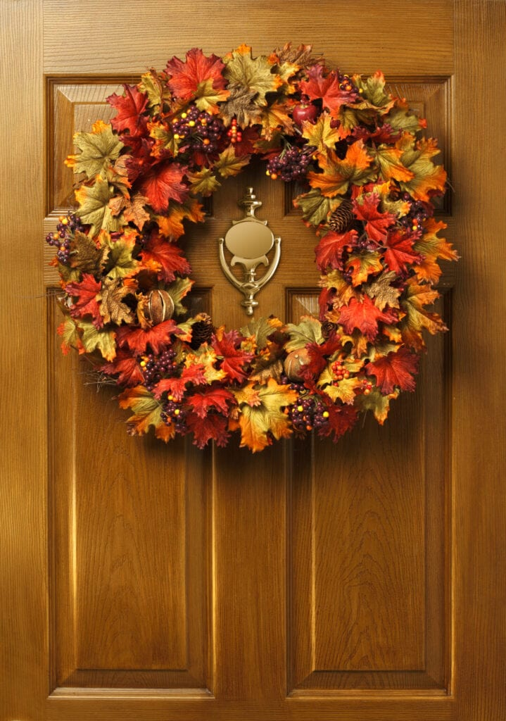 A fall wreath hanging on a door.To see more of my Thanksgiving images click on link below: