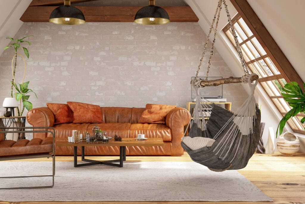 Loft room with leather couch and hammock