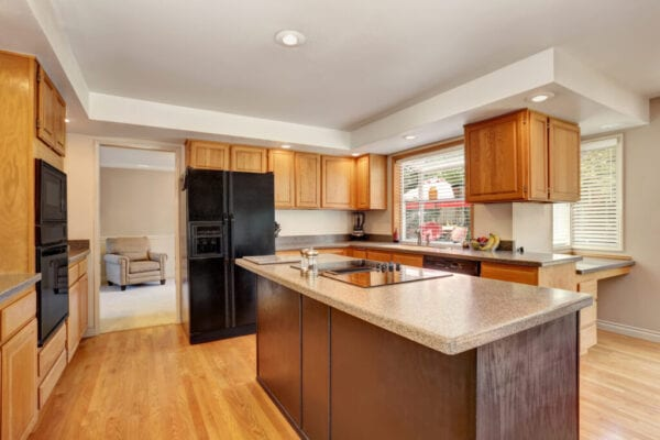 Kitchen room interior with with granite counter top and island.