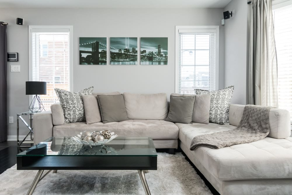 Mid century modern family room, gray couch, neutral colors
