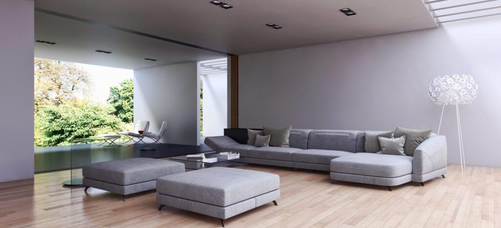 Contemporary living room, gray sofa and ottomans