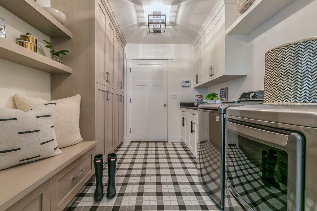 Rain boots and gingham decorated flooring in new custom home