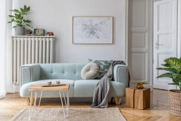 Modern scandinavian living room interior with stylish mint sofa, furnitures, mock up poster map, plants, and elegant personal accessories. Home decor. Interior design. Template. Ready to use.