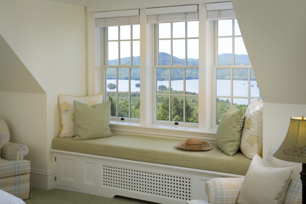 Bedroom with window seat and view, Moosehead Lake Area, Greenville, Maine, USA.