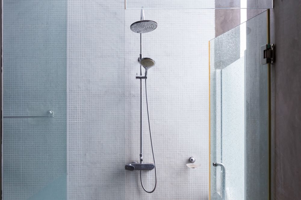 Private outdoor shower with tile and glass walls