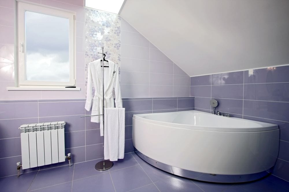 Bathroom with lilac tiles on wall and floor