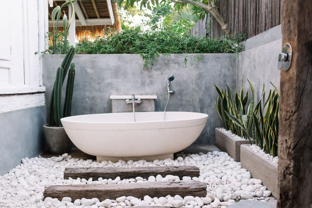 Outdoor bathtub with shower head