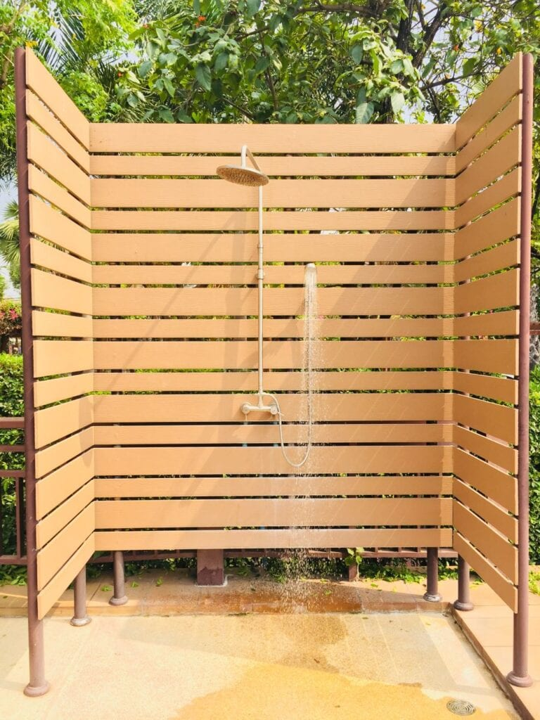 Simple outdoor shower with wood panel partition