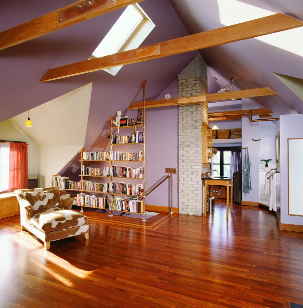 Rustic style room with bookshelves and lilac walls