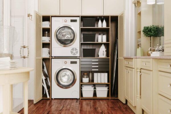 Washing machine and dryer in a luxury bathroom.