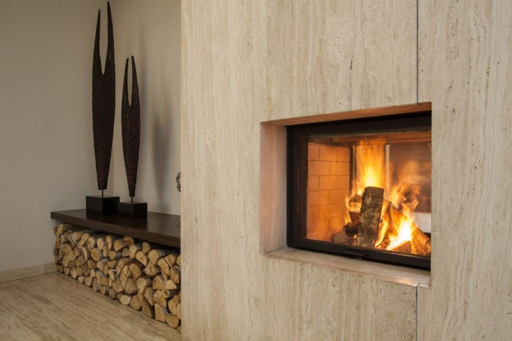 Burning fireplace surrounded by wood