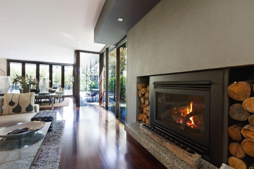 Industrial style metal fireplace in wide open living room