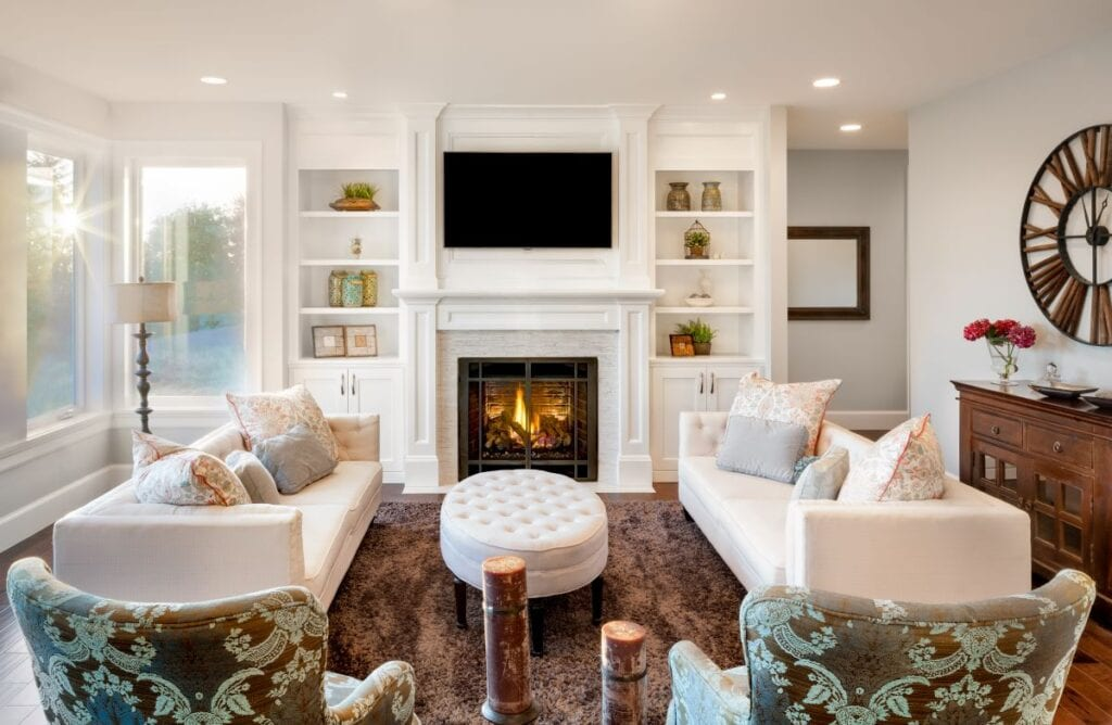 Beautiful living room with white couches and fireplace