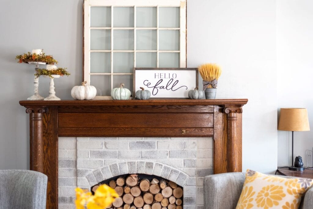 Rustic chic fall decorations on wood and brick fireplace mantel