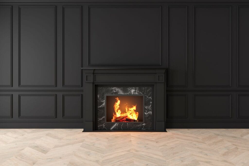Fireplace surrounded by black marble and black wood