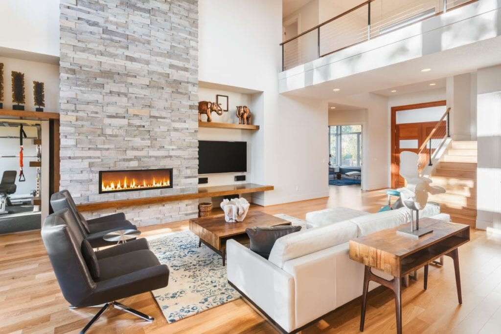 Gray stone fireplace in luxurious living room