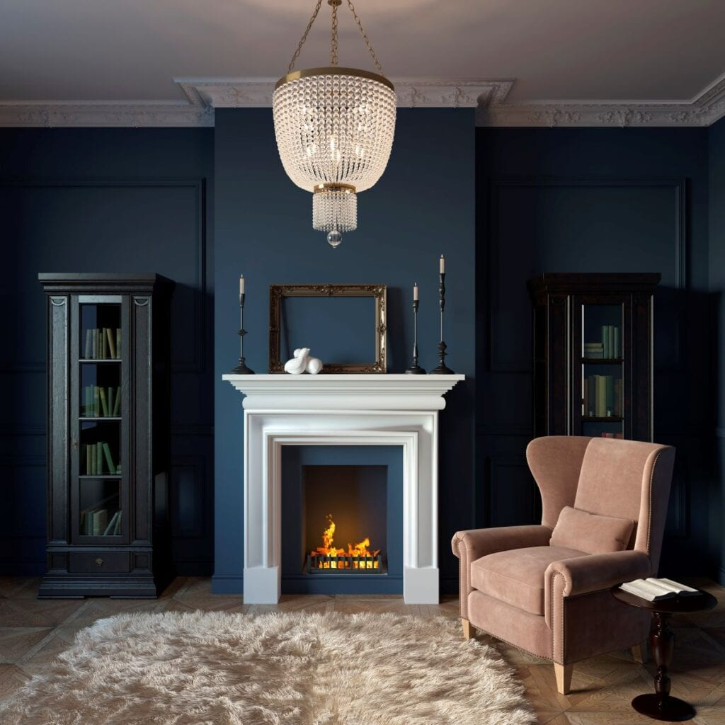 Modern living room with white wood fireplace and deep blue walls