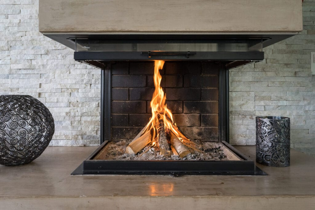 Modern luxury fireplace with brick and metal