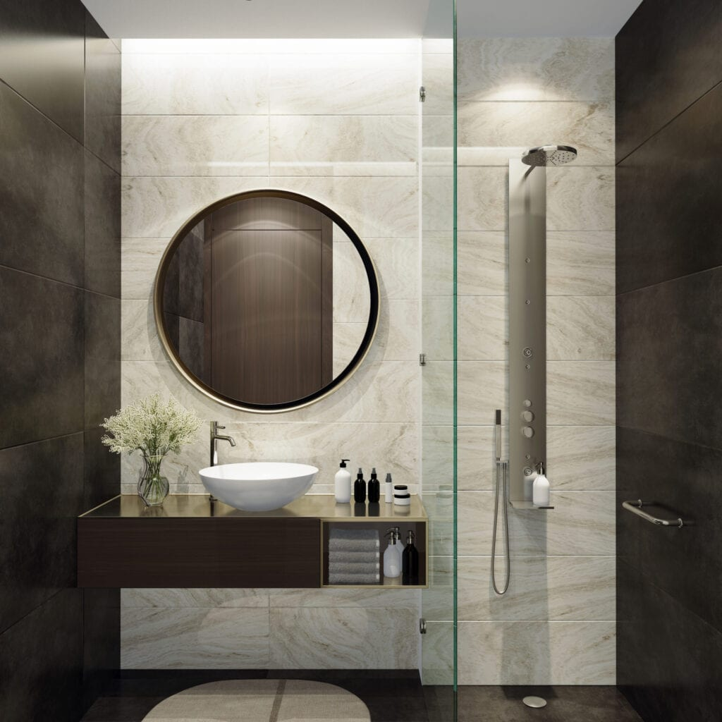 Luxurious bathroom with natural black stone tiles and white stone tiles. Round mirror. Small bathroom.