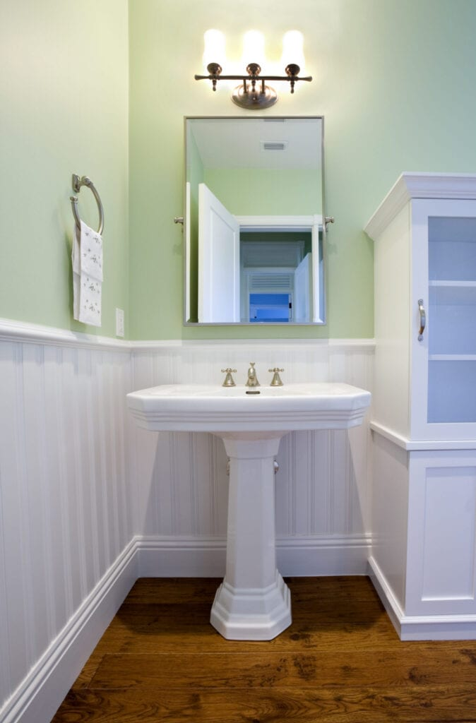 Pedestal sink in a bathroom.