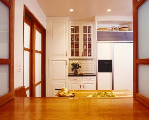 Kitchen with White Cabinetry and Wood Trim