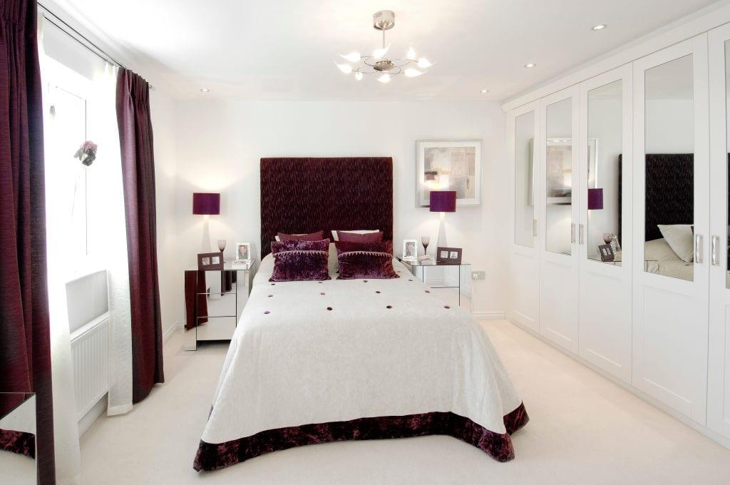 Luxury bedroom with purple comforter