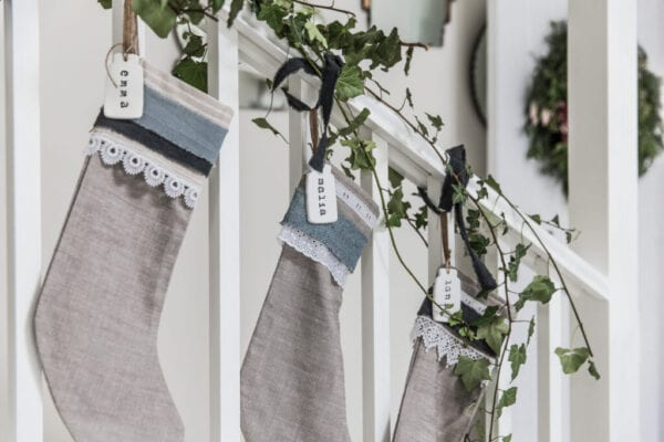 Stockings used as creative christmas stair decorations