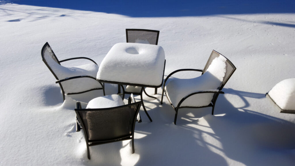 snow-covered patio furniture