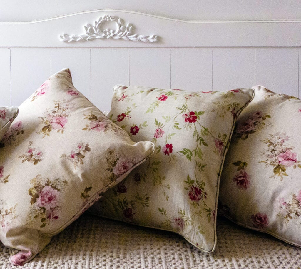 A romantic detail of a bed inspired by French style