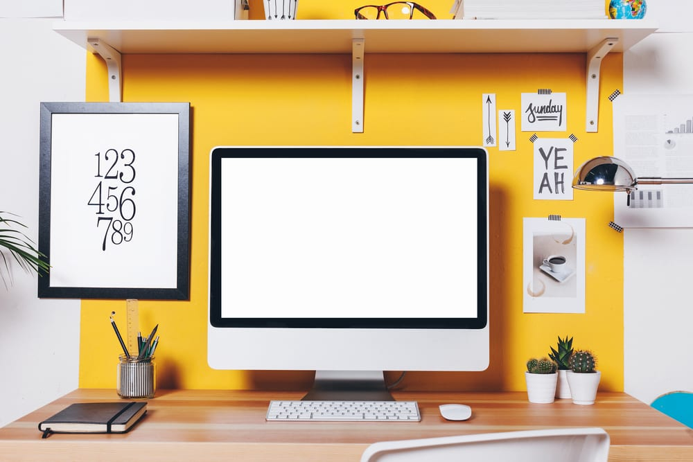 Bright yellow wall for desk